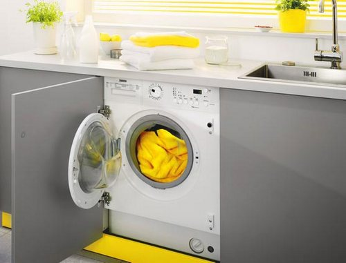 Особенности применения встраиваемой стиральной машинки на кухне